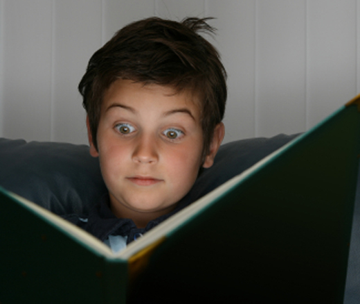 Boy enthralled by book